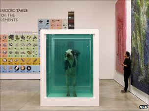 "A piece by British artist Damien Hirst entitled ""Love""s Paradox"", cows in a formaldehyde solution, at the White Cube Gallery in London, 01 June 2007"