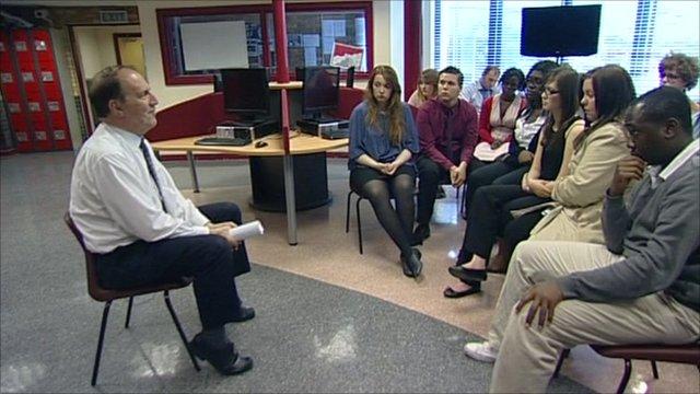 Liberal Democrat deputy leader Simon Hughes sitting with students