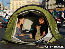 Spanish demonstrators take part in some city camping