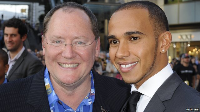 Director John Lasseter and Lewis Hamilton arrive at the Cars 2 film premiere in Hollywood