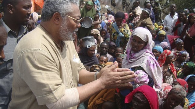 Jerry Rawlings, AU envoy to Somalia, gestures as he speaks to displaced people during a visit to camps in southern Mogadishu, Somalia