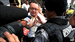 Columnist Emilio Palacio outside the court