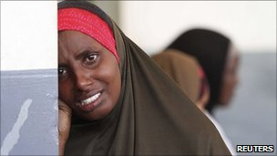 A Somali woman weeps for her dead child at Banadir hospital in Mogadishu, July 21, 2011.