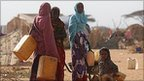 Somalian refugees travel to collect water on the edge of the Dagahaley refugee camp