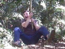 Peter Allison swinging on a vine