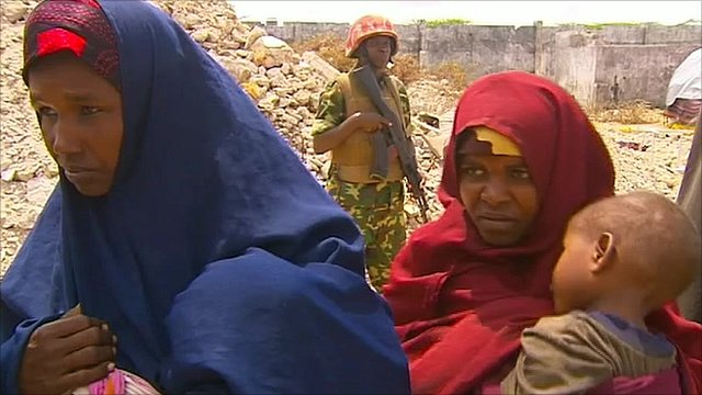 Women line up in an aid camp near Mogadishu