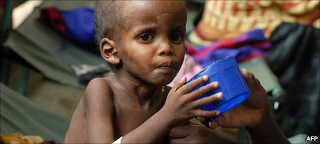 A displaced Somali mother attends her malnourished child at southern Mogadishu's Banadir hospital on 19 July  2011