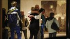 People embrace at a hotel where relatives of victims and survivors of the island shooting gathered in Sundvollen, Norway, 22 July 2011