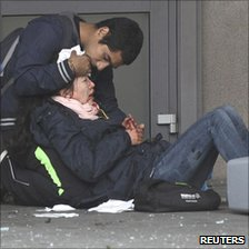Injured woman is comforted after Oslo bombing, 22 Jul 11