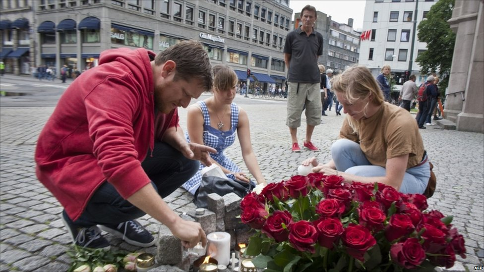 Flowers and candles for the victims of the twin attacks are set out in Oslo, 23 July
