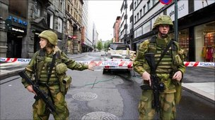 Soldiers guard a cordoned-off area in Oslo, Norway following Friday's bomb attack