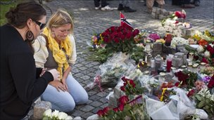 People gather outside the Oslo Cathedral to mourn and show their respect for the victims of the attacks