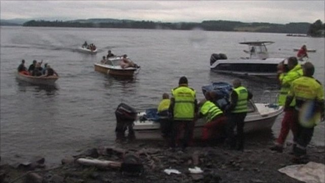 Photo: Scene of boats approaching personnel on the shore