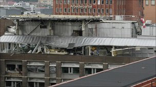 "A view of the damage at a building after Friday""s bomb blast in downtown Oslo"