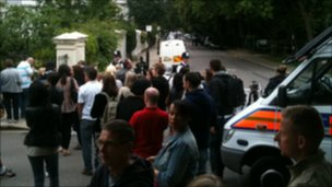Crowds are continuing to gather outside the house in Camden, north London
