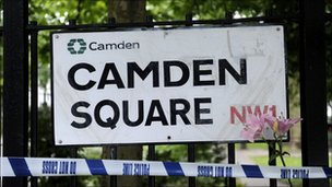 A flower is placed by a road sign near the north London flat in