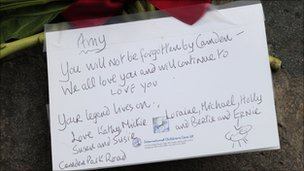 A note is left near the flat where Amy Winehouse lived in north London