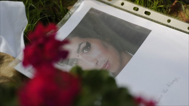 Picture of Amy Winehouse among flowers