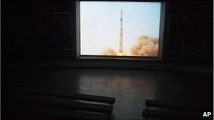 A video shows the launch in 2009 of a North Korean Unha-2 rocket on a screen inside a hall in Pyongyang, 18 April 2011