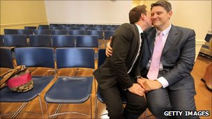 A gay couple embrace on their wedding day at the Brooklyn City Clerk&#039;s office in New York, 24 July