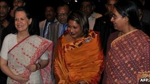 From right: Bangladeshi Foreign Minister Dipu Moni, Prime Minister Sheikh Hasina&#039;s daughter and autism expert Saima Hossain, India&#039;s Congress party president Sonia Gandhi at the Dhaka airport on 24 July 2011
