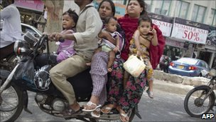 Six people on a motorcycle in Karachi