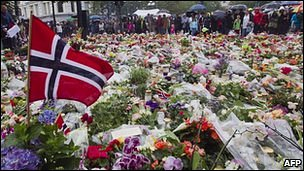 A Norwegian flag among flowers left by people in memory of the victims killed in twin terror attacks on 22 July