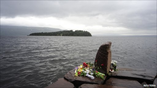 Flowers are placed at the Utvika campsite where victims were evacuated to from Utoeya Island 
