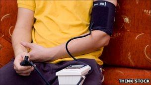 A man measuring blood pressure