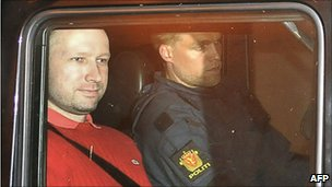 Anders Behring Breivik leaves the courthouse in a police car in Oslo, 25 July