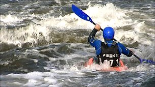 Canoeist in white water at the National Watersports Centre, Holme Pierrepont, Nottingham
