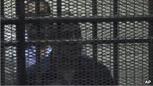 Habib al-Adly in the defendants' box in a Cairo court, 25 July