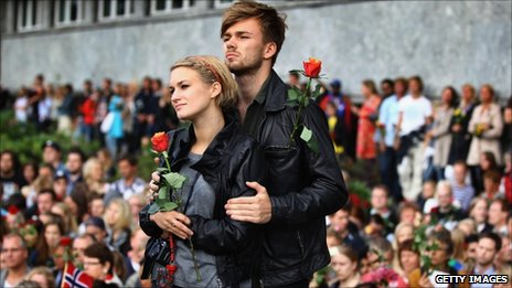A couple in Oslo hold roses, 25 July
