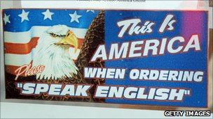 A sign at Geno&#039;s in Philadelphia advises customers to speak English