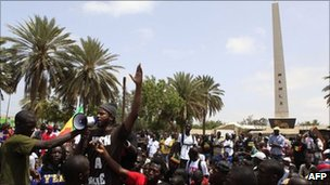 Senegalese rapper Omar Toure addresses a rally on Saturday in Dakar
