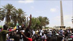 Senegalese rapper Omar Toure addresses a rally on Saturday in Dakar