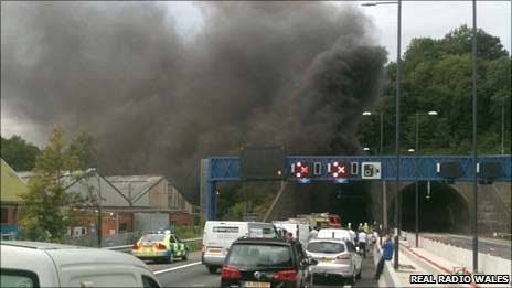 Traffic is halted as smoke billows from the Brynglas tunnels at Newport
