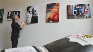 Lee Karen Stow hanging photographs