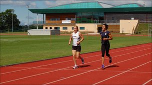 Dame Kelly Holmes & Surrey athlete Dani Christmas on the running track at Tonbridge School