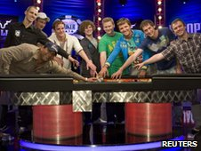 The nine finalists celebrate making it to the final table