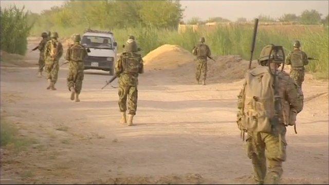Soldiers walking in Afghanistan