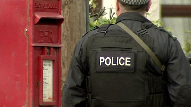 Armed police officer on guard