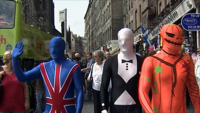 Men wearing 'morphsuits'