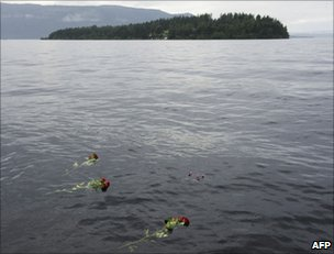 Flowers float in Lake Tyrifjorden with Utoeya island in the background, 26 July