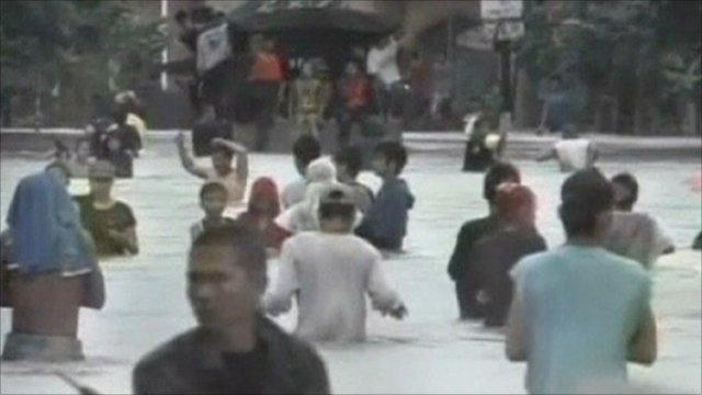 People walking on a flooded street
