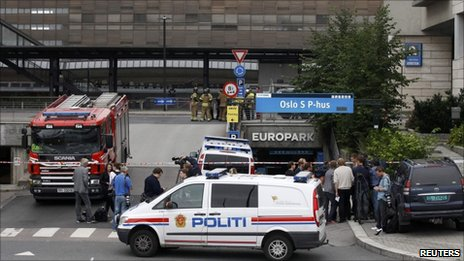 A police vehicle blocks the entrance to Oslo's central train station after a suspicious suitcase triggered a brief evacuation, 27 July.