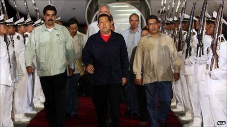 Venezuelan President Hugo Chavez (centre) arrives in Caracas from Cuba on 23 July 2011.