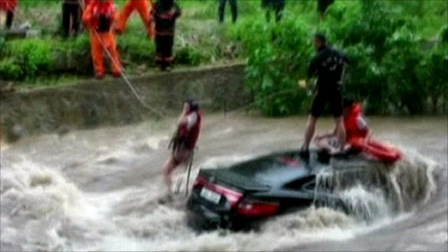 People rescued from a car in the floods