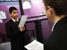 School Reporters practice reading their scripts