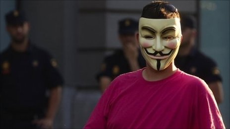 "A demonstrator wearing an ""Anonymous"" group mask attends an assembly against the ""Euro Pact"" and the handling of the economic crisis near Madrid""s Parliament"